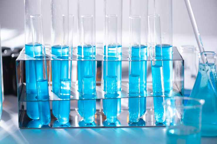 A row of test tubes containing blue liquid